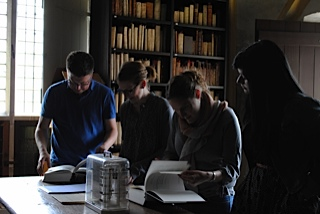 The team checking out some books in the upper library of Zutphen (photo courtesy of Julie Somers)